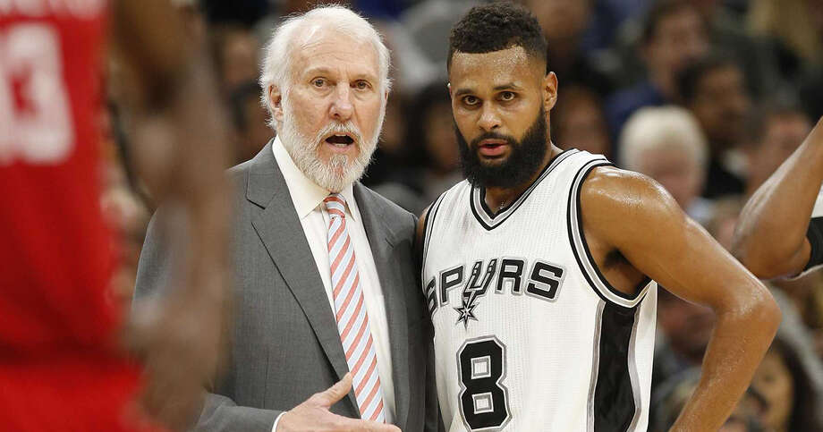 Spurs head coach Gregg Popovich talks with Patty Mills (08) in the game against the Houston Rockets during their game at the AT&T Center on Wednesday, Nov. 9, 2016. Photo: Kin Man Hui /San Antonio Express-News