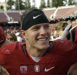 FILE - In this Nov. 5, 2016, file photo, Stanford running back Christian McCaffrey (5) smiles after Stanford defeated Oregon State, 26-15, in an NCAA college football game, in Stanford, Calif. McCaffrey is done playing college football. Stanford�s star running back announced on Twitter on Monday, Dec. 19, 2016, that he will not play in the 16th-ranked Cardinal�s Sun Bowl game against North Carolina (8-4) on Dec. 30 in El Paso, Texas. �Very tough decision, but I have decided not to play in the Sun Bowl so I can begin my draft prep immediately,� McCaffrey said. (AP Photo/Marcio Jose Sanchez, File)