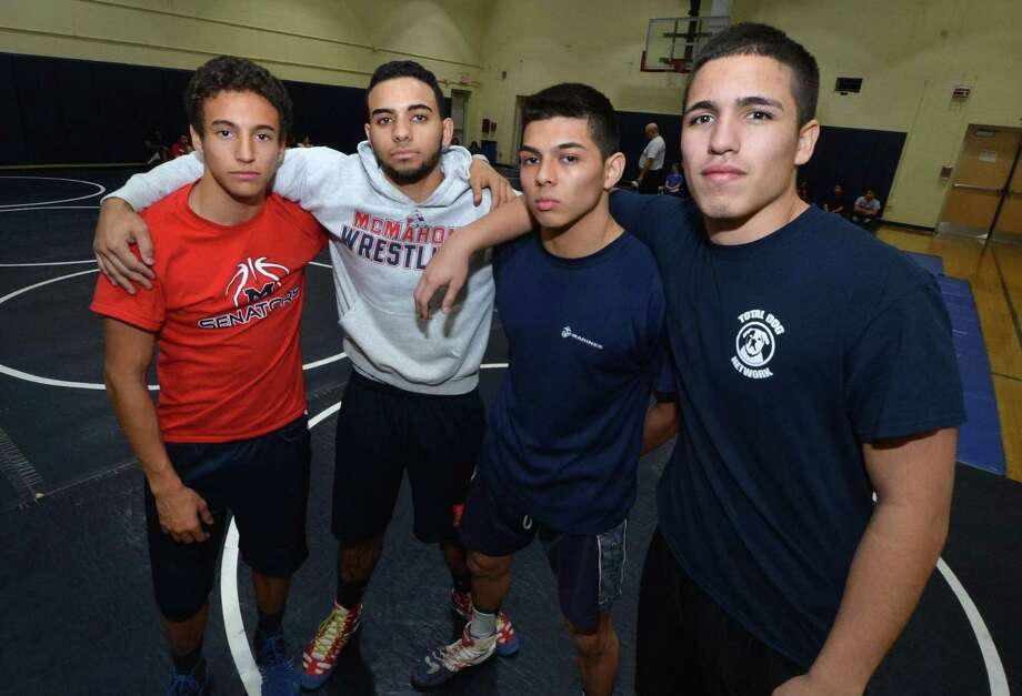 Brien McMahon wrestling captains, from left, Nicolas Gonzalez, Felipe Silva, Jason Martinez and Jeffrey Capone. Photo: Alex Von Kleydorff / Hearst Connecticut Media / Connecticut Post