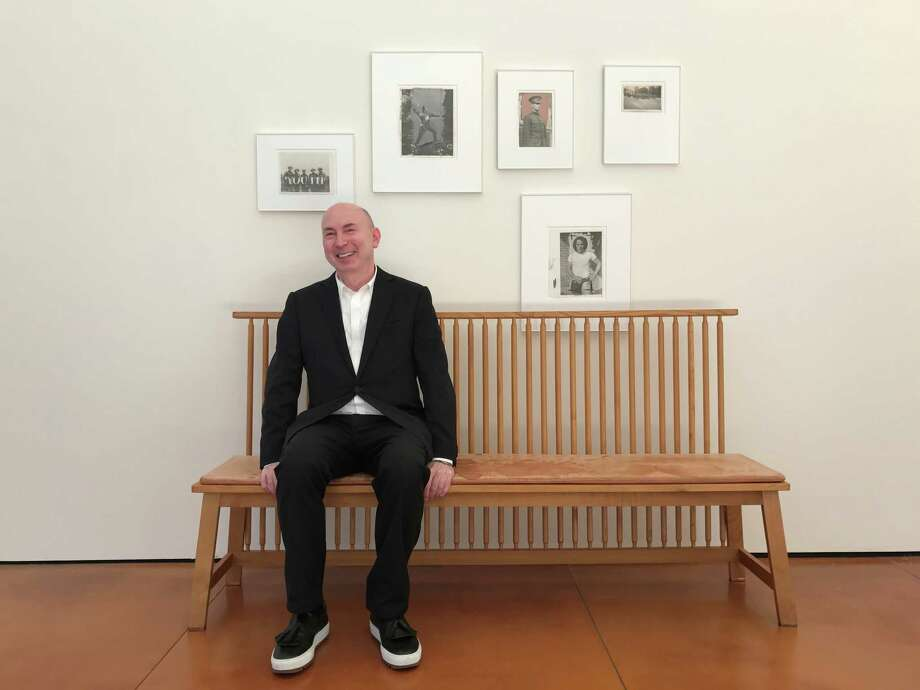 "Design guru Murray Moss purposefully hung a collection of vintage news prints at Hiram Butler Gallery as ""haphazardly"" as they might be at someone's home. Photo: Molly Glentzer"