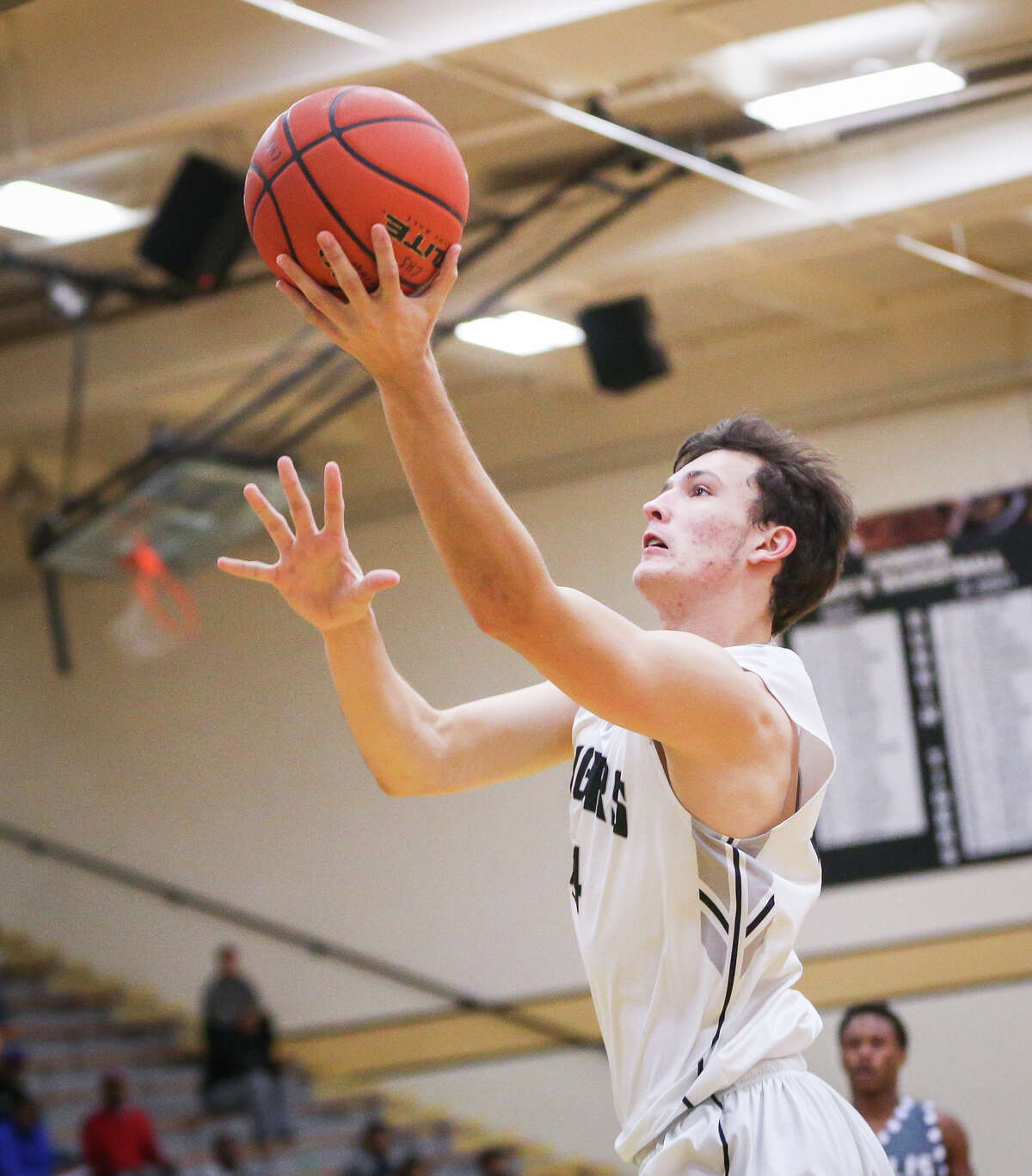 ConroeÂ?'s Joshua Berry (44) shoots during the varsity boys basketball game against Willis on Monday, Dec. 19, 2016, at Conroe High School. (Michael Minasi)