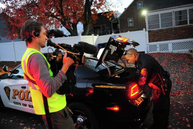 Crews from LivePD, a new reality show from A&E, patrol with members of the Bridgeport Police Department in Bridgeport, Conn. on Thursday Nov. 3, 2016.