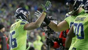 SEATTLE, WA - DECEMBER 15:  Wide receiver Tyler Lockett #16 of the Seattle Seahawks celebrates his touchdown against the Los Angeles Rams at CenturyLink Field on December 15, 2016 in Seattle, Washington.  (Photo by Otto Greule Jr/Getty Images)