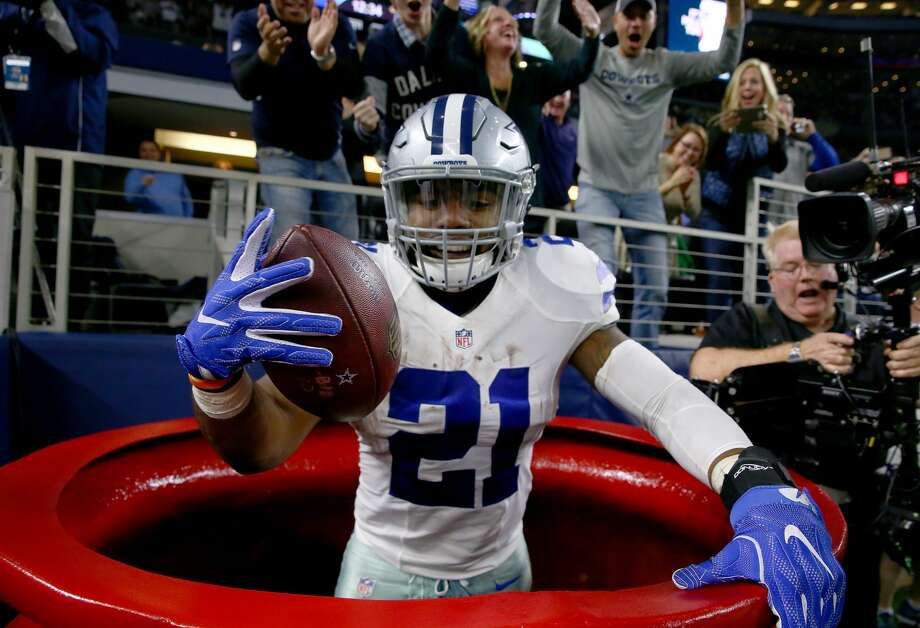 ARLINGTON, TX - DECEMBER 18:  Ezekiel Elliott #21 of the Dallas Cowboys celebrates after scoring a touchdown by jumping into a Salvation Army red kettle during the second quarter against the Tampa Bay Buccaneers at AT&T Stadium on December 18, 2016 in Arlington, Texas.  (Photo by Tom Pennington/Getty Images) Photo: Tom Pennington/Getty Images