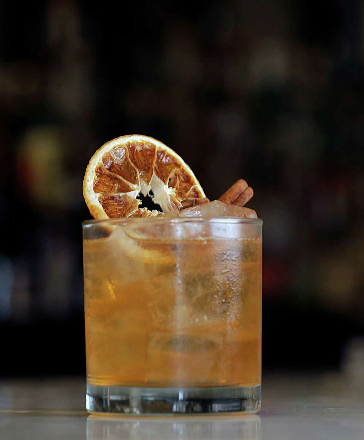 The Golden Girl cocktail, Cointreau, BŽnŽdictine, buttered rum, simple syrup with cinnamon stick and dehydrated orange garnish mixed by Judith Piotrowski at Pax Americana Oct. 12, 2016, in Houston. ( James Nielsen / Houston Chronicle )