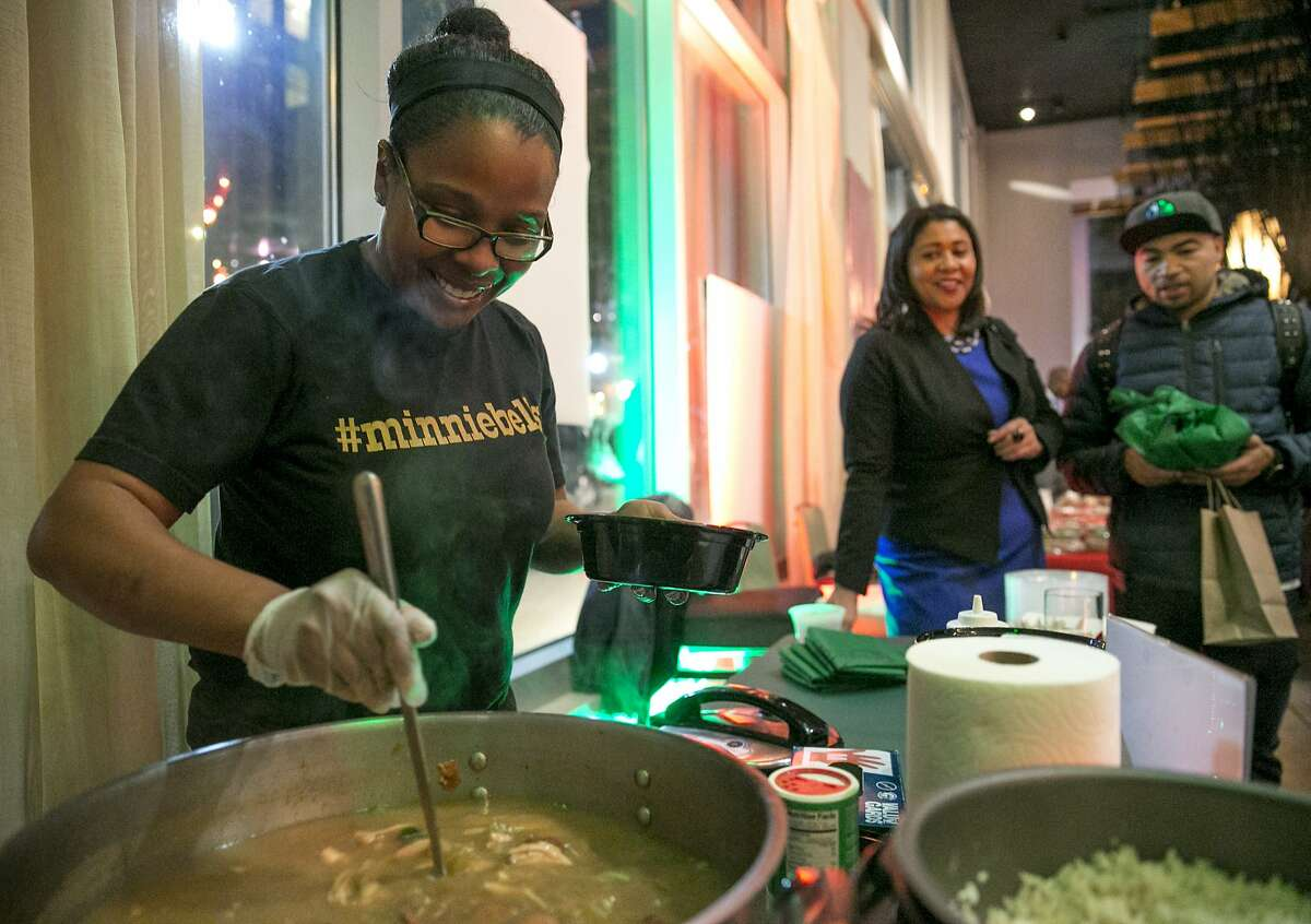 From left: Fernay McPherson fills a bowl of Gumbo to a customer at the Fillmore Heritage Center on Monday, Dec. 19, 2016 in San Francisco, Calif. McPherson is the chef-owner of Minnie Bells.