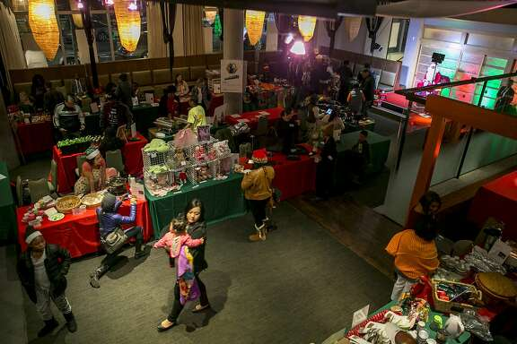 Vendors and shoppers at the Fillmore Heritage Center on Monday, Dec. 19, 2016 in San Francisco, Calif.