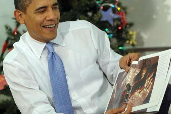 """President Barack Obama reads """"The Polar Express"""" to children at the Boys and Girls Club of Washington in December 2009."""