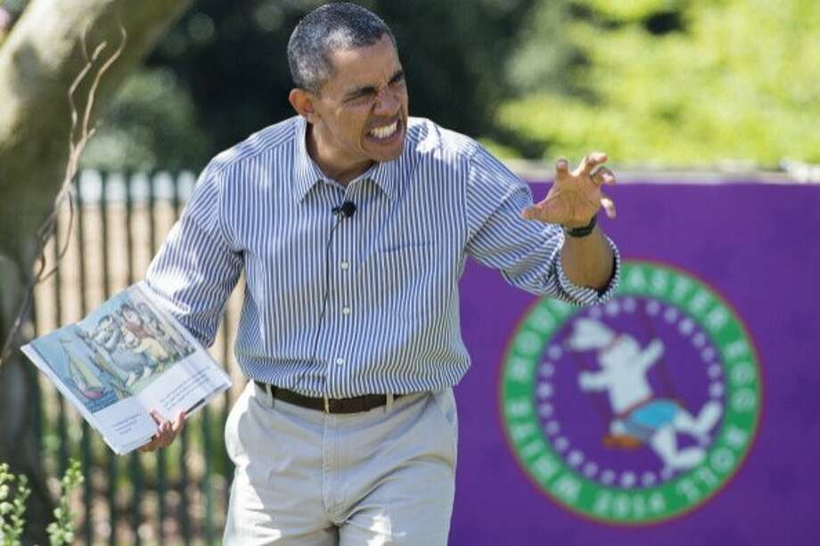 """President Obama reads """"Where the Wild Things Are"""" to children attending the annual White House Easter Egg Roll in 2014. Photo: Saul Loeb / AFP / Getty Images"""