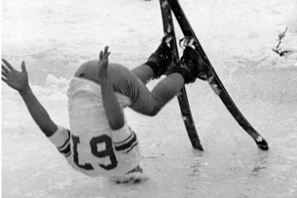 """Original caption: """"Participant in annual Slush Cup Ski festivities at Mount Baker used his head in race traditionally marking end of the ski season. Skiers went down slopes trying to navigate pond of slush at foot of run -- with results like this."""" July 5, 1967. AP photo."""