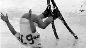 "Original caption: ""Participant in annual Slush Cup Ski festivities at Mount Baker used his head in race traditionally marking end of the ski season. Skiers went down slopes trying to navigate pond of slush at foot of run -- with results like this."" July 5, 1967. AP photo."