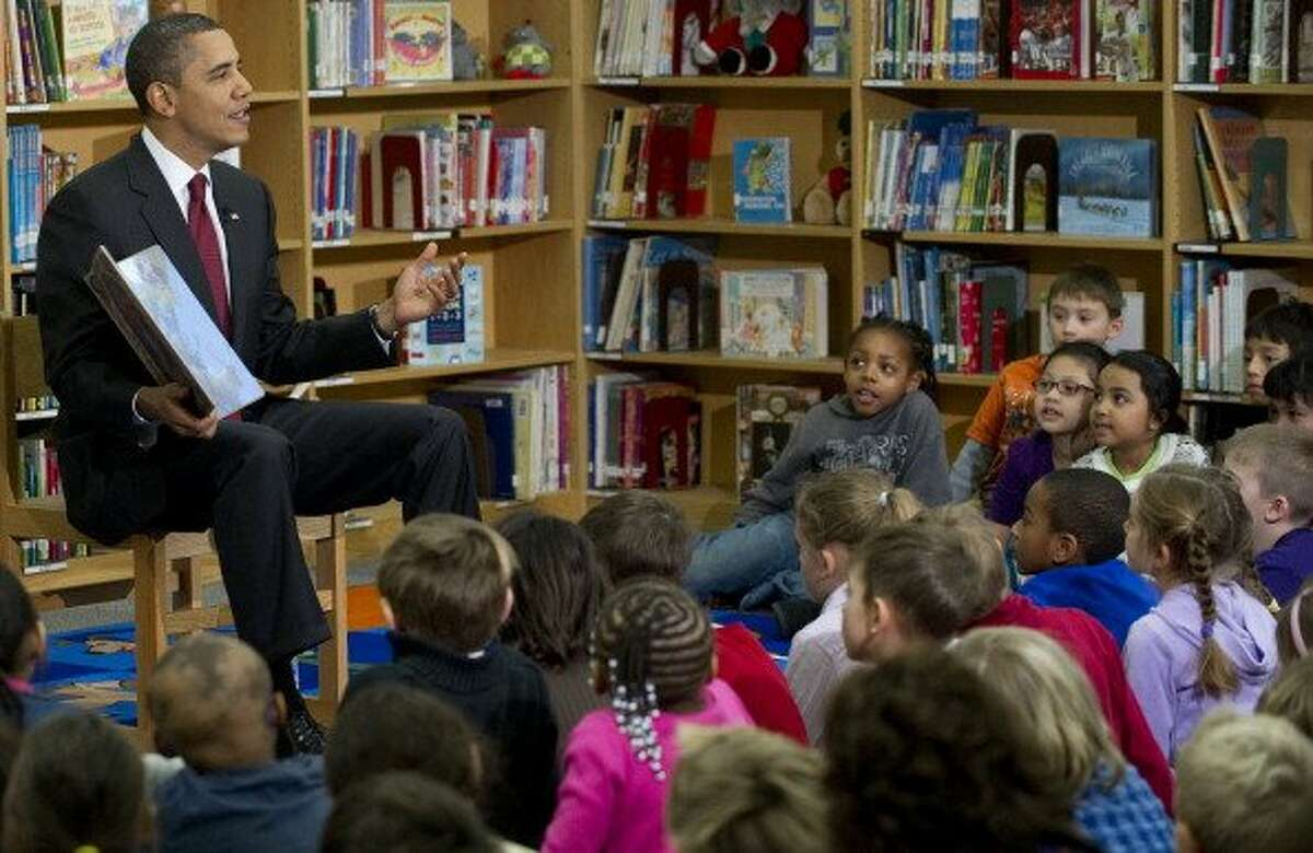 """President Obama reads """"'Twas the Night Before Christmas,"""" to students at Long Branch Elementary School in Arlington, Va., in December 2010"""