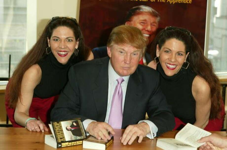 "Donald Trump poses for a picture with two fans while signing copies of his book ""How To Get Rich"" in New York City in 2004. Photo: Peter Kramer / Getty Images"