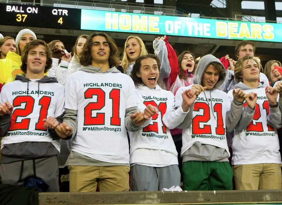 Students from The Woodlands High School sing the school song wearing t-shirts in support of linebacker Grant Milton (21) after the Highlanders' 41-18 win over Round Rock in a Division I Region II-6A final game at McLane Stadium Saturday, Dec. 3, 2016, in Waco. Milton suffered a serious head injury during the team's Nov. 26 win over Austin Bowie in a UIL Class 6A Division I regional semifinal playoff game at Baylor's McLane Stadium. He was taken to a Waco hospital to have emergency surgery where he remains in a medically induced coma. Photo: Jason Fochtman, Staff Photographer / Houston Chronicle