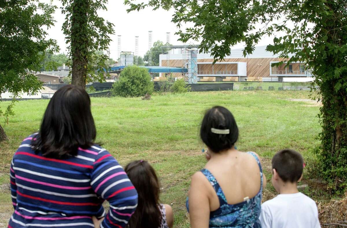 From left, Theresa Cavin; her daughter, Hannah Quintanilla, 7; her mother, Valerie Gonzales; and her son Austin, 9, look at the White Oak Music Hall. They live nearby and complain about the outdoor concerts.