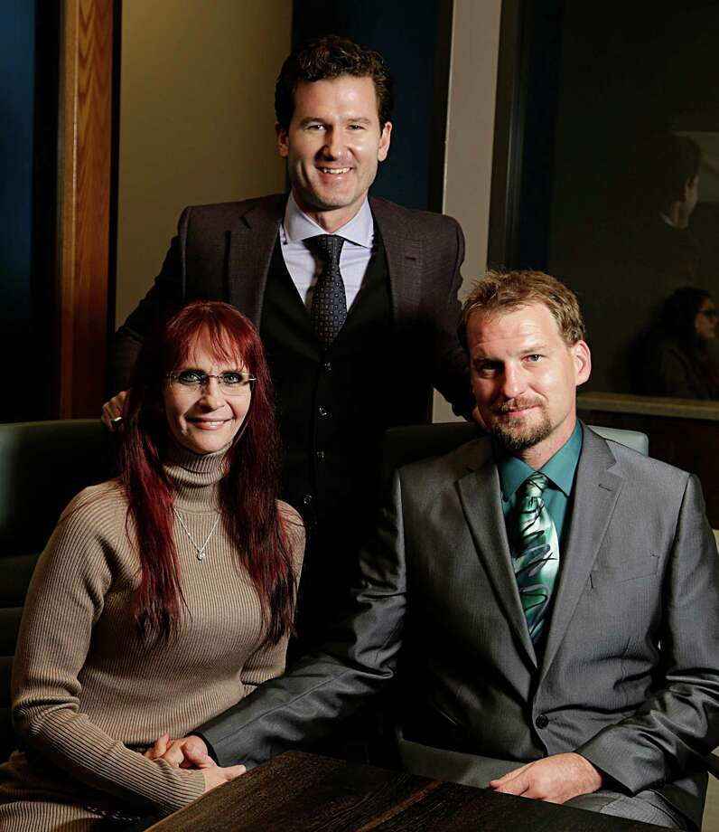 Audra Benoit left, and her husband Kent Langerlan right, pose for a portrait with their attorney Josh Davis Dec. 5, 2016, in Houston. ( James Nielsen / Houston Chronicle ) Photo: James Nielsen, Staff / © 2016  Houston Chronicle