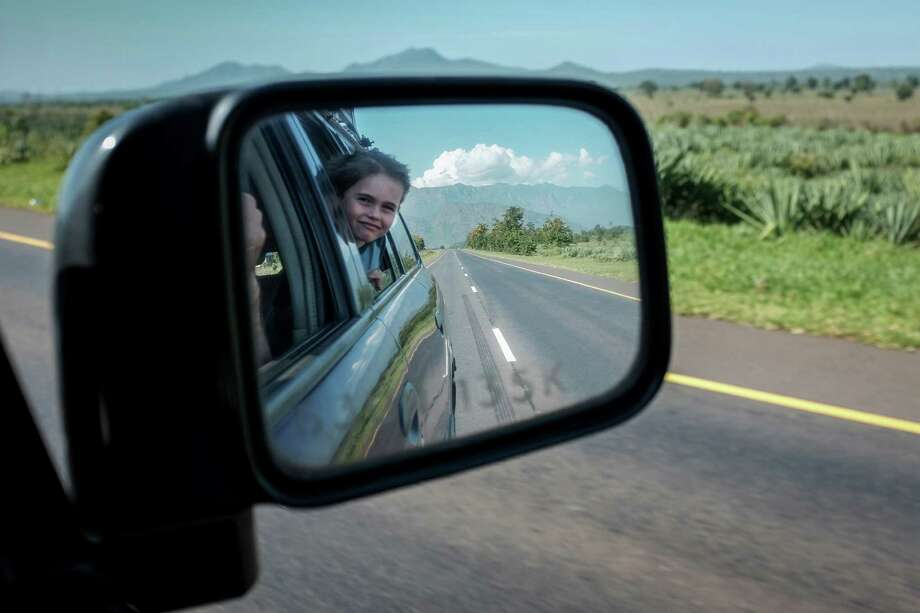 Apollo, 6, the son of Jeffrey Gettleman,   the East Africa bureau chief for The New York Times, views the scenery in Tanzania during a road trip across Africa with his family and another family, in December of 2015. The two married couples, with five young children between them, traveled through six African countries and 4,250-miles in 16 days, starting in Nairobi and ending in Cape Town. (Jeffrey Gettleman/The New York Times) Photo: JEFFREY GETTLEMAN, STF / NYTNS