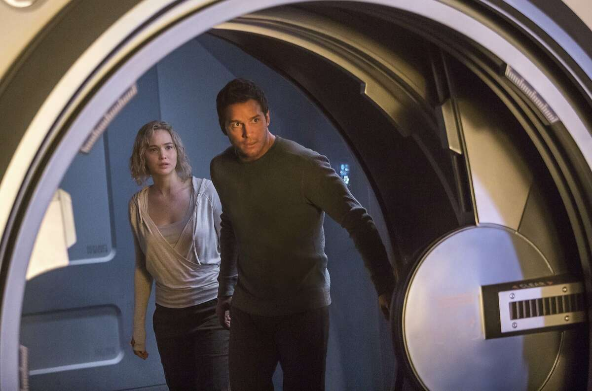 This image released by Columbia Pictures, Jennifer Lawrence, left, and Chris Pratt in a scene from the film, Passengers.