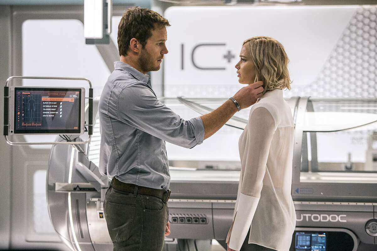 This image released by Columbia Pictures, Chris Pratt, left, and Jennifer Lawrence in a scene from the film, Passengers.