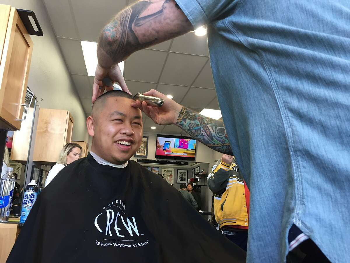 Barber Todd Sweeney gave haircuts to children and adults who use the programs at Gatepath, a 95-year-old San Mateo nonprofit serving people with special needs and disabilities