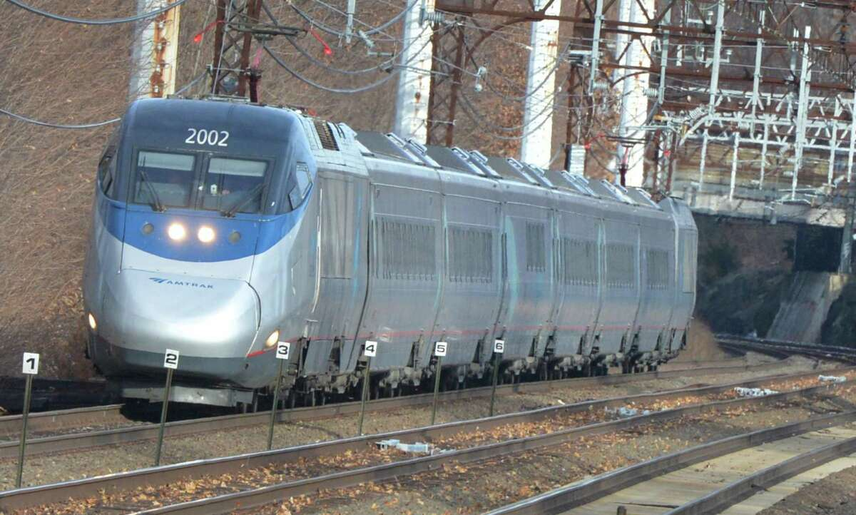 Amtrak's Acela Express passes through Norwalk westbound on Monday December 19, 2016 in Norwalk Conn. Amtrak wants to re-route its tracks between Greenwich and Greens farms to make high speed rail travel possible