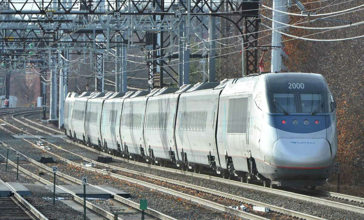 Amtrak's Acela Express passes through Norwalk westbound on Monday. Amtrak wants to re-route its tracks between Greenwich and Greens Farms to make high-speed rail travel possible.