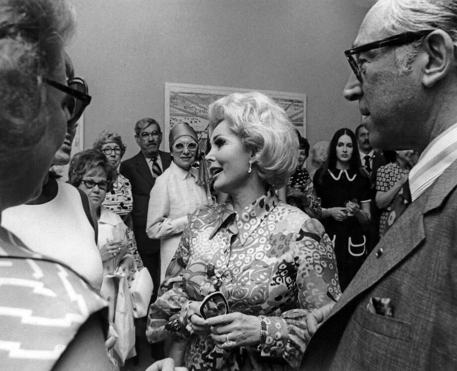 May 7, 1970: Zsa Zsa Gabor is surrounded by admirers at the Neiman Marcus executive offices in Houston. She was in Houston to talk about her new line of cosmetics, Zsa Zsa Ltd. Photo: Si Dunn, Houston Chronicle / Houston Chronicle