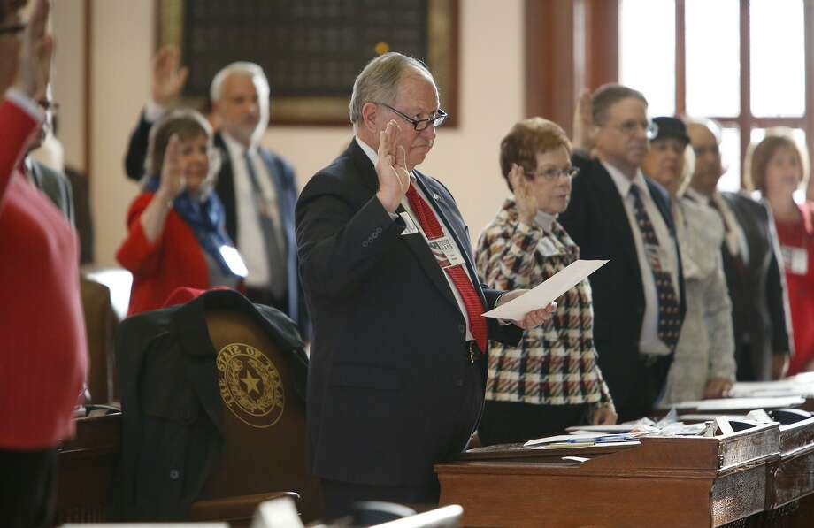 Texas Electoral College electors take the oath of office in the House Chamber at the Texas Capitol on Dec. 19, 2016. Federal lawsuits have been filed in four states, including Texas, that contest the winner-take-all method that states use to allocate their Electoral College votes. Photo: San Antonio Express-News File Photo