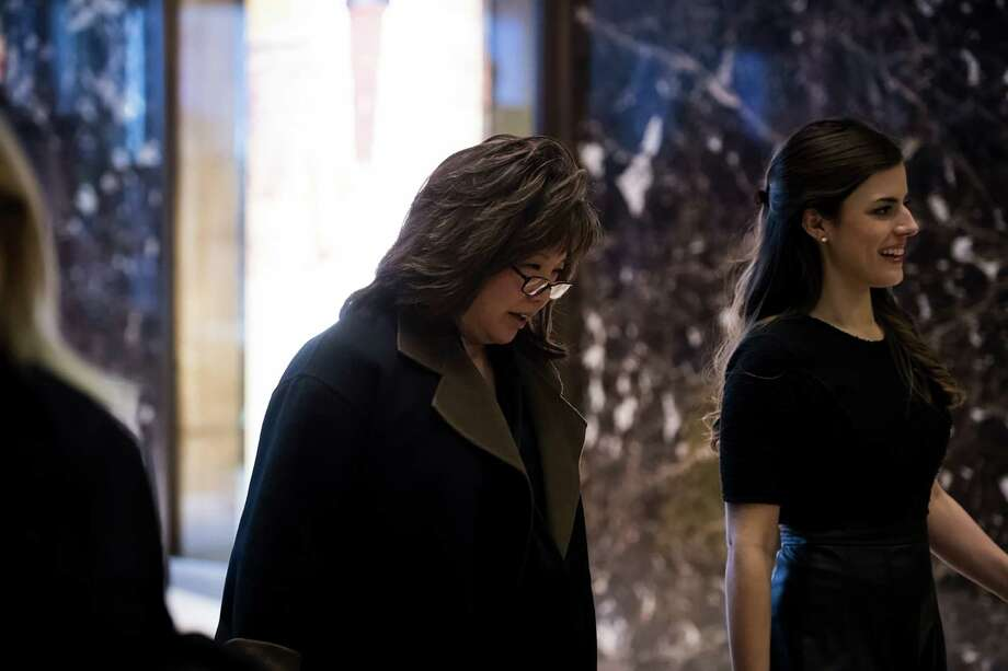 Debra Wong Yang, left, former U.S. attorney for the Central District of California, is escorted into Trump Tower in New York earlier this month. Photo: HILARY SWIFT, STR / NYTNS