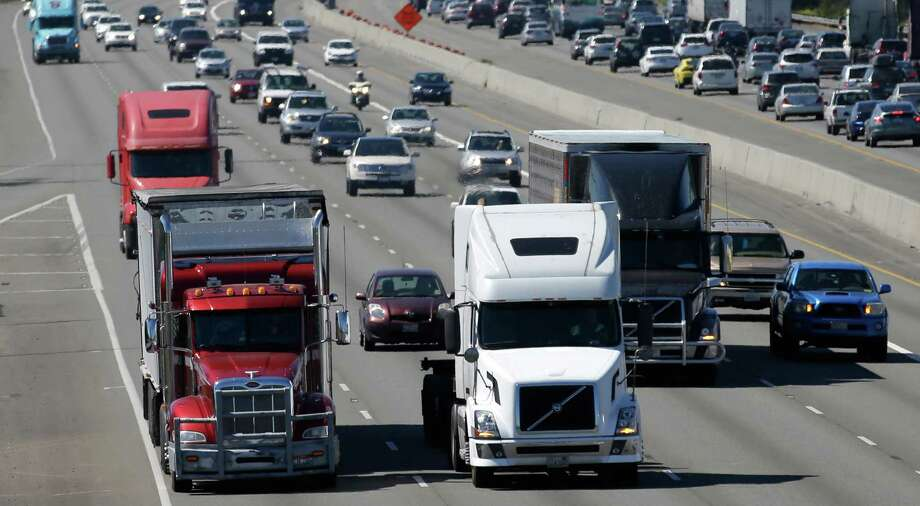Trucks mix with other traffic near the Port of Tacoma. Safety advocates fear a rule on electronically limiting truck speeds could be ditched. Photo: Ted S. Warren, STF / Copyright 2016 The Associated Press. All rights reserved. This material may not be published, broadcast, rewritten or redistribu