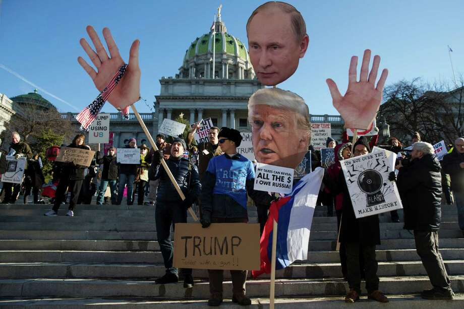 Protesters demonstrate ahead of Pennsylvania's 58th Electoral College at the state Capitol in Harrisburg, Pa., Monday, Dec. 19, 2016. The demonstrators were waving signs and chanting in freezing temperatures Monday morning as delegates began arriving at the state Capitol to cast the state's electoral votes for president. (AP Photo/Matt Rourke) Photo: Matt Rourke, STF / Copyright 2016 The Associated Press. All rights reserved.