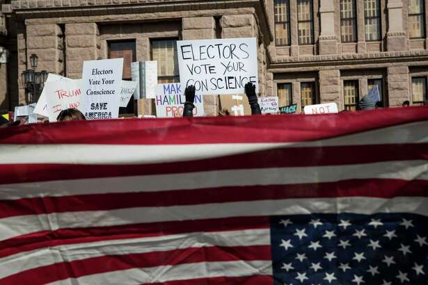 Demonstrators gather outside the Texas State Capitol in an attempt to influence the 38 Republican electors from across the state to not vote for Donald Trump when they cast their formal ballots for president of the United States in Austin, Texas, Monday, Dec. 19, 2016. (AP Photo/Tamir Kalifa)
