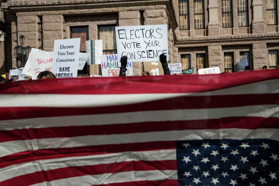 Demonstrators gather outside the Texas State Capitol in an attempt to influence the Republican electors from across the state to not vote for Donald Trump when they cast their formal ballots for president of the United States in Austin, Texas, Monday, Dec. 19, 2016. (AP Photo/Tamir Kalifa) Photo: Tamir Kalifa, FRE / FR170773 AP