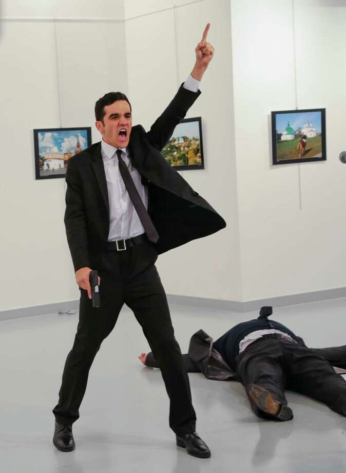 """A man identified as an off-duty police officer shouted """"God is great!"""" as he gunned down Russia's ambassador to Turkey on Monday in Istanbul. Photo: Burhan Ozbilici, STF / AP"""