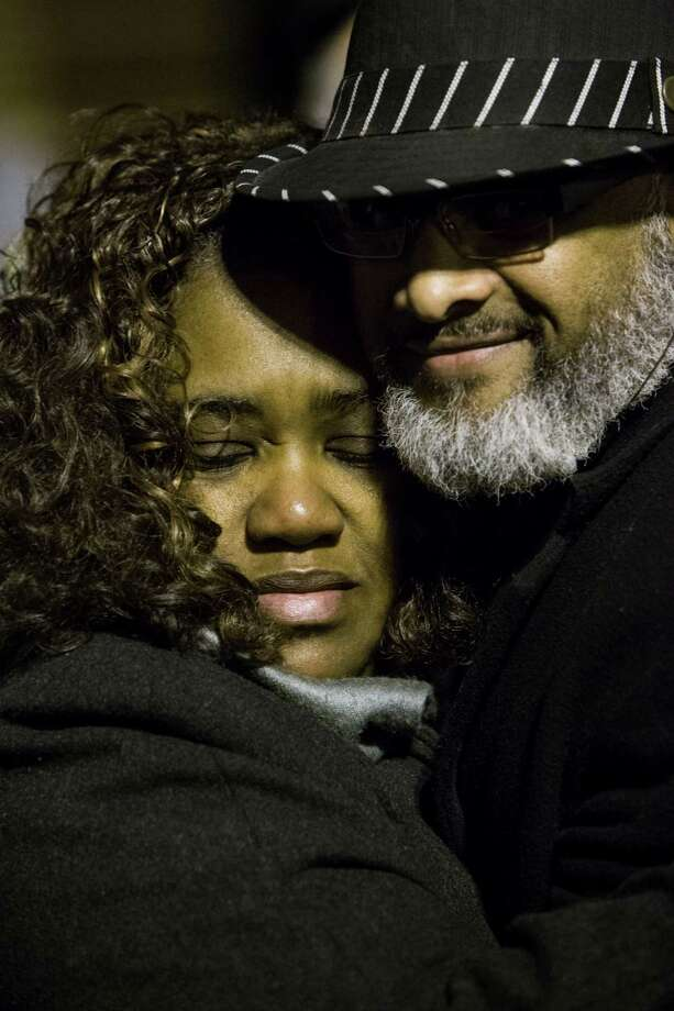 Ann Williams and Errol Jones embrace as mourners gather at a candlelight vigil for Alief ISD Trusteee Dedre Jefferson in Houston on Monday. Photo: Brett Coomer, Houston Chronicle / © 2016 Houston Chronicle