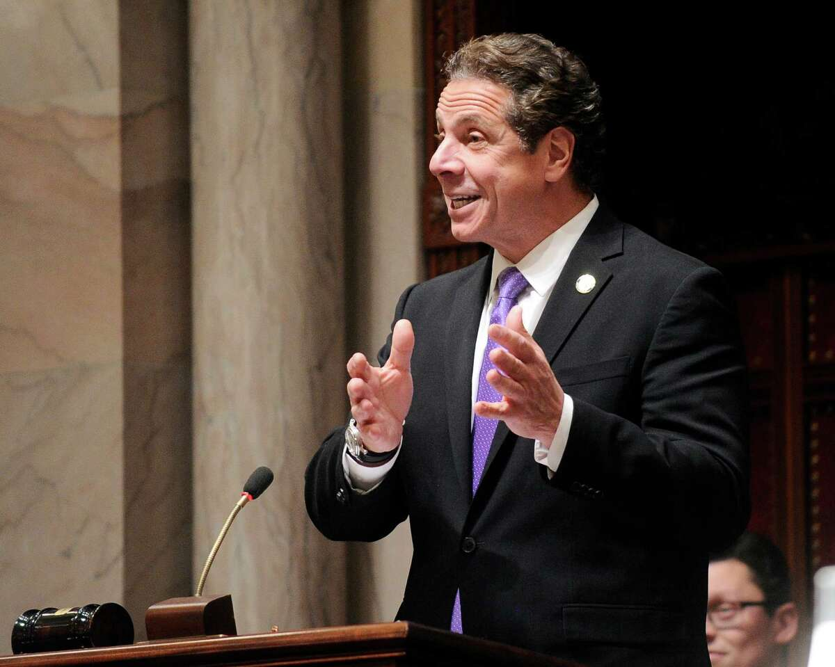New York Gov. Andrew Cuomo speaks to members of New York state's Electoral College before voting for president in the Senate Chamber of the Capitol in Albany, N.Y., Monday, Dec. 19, 2016. (AP Photo/Hans Pennink via AP, Pool) ORG XMIT: NYHP110