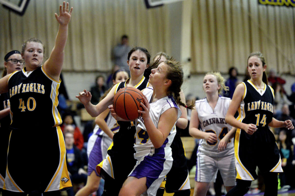 NICK KING | nking@mdn.net Calvary Baptist's Courtney Warner, right, looks to shoot as Faith Davison's Allison Ahrens, center, and Emily Vanaman, left, defends during the second quarter on Monday at Calvary Baptist Academy. The Kings won 47-36.