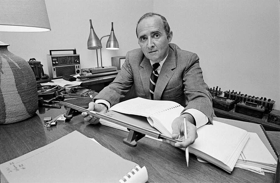 Louis Harris works in his study at his home in New York in 1971. Harris  preferred to be called a public-opinion analyst rather than a pollster, which he  believed trivialized his work. Photo: DONAL F. HOLWAY, STF / NYTNS