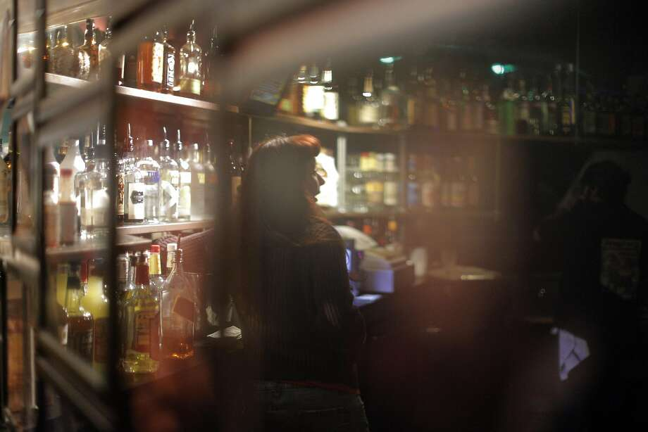 Bartender Lisa Hyde at the DNA Lounge. The nightclub is one of many in California that could benefit under a new state law that allows extended serving hours for alcohol. Photo: Carlos Avila Gonzalez, The Chronicle