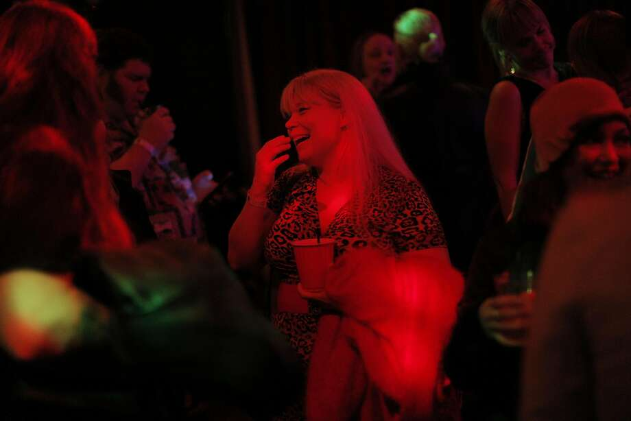"Performer Pearl E. Gates in the audience supporting her fellow performers during a Hubba Hubba Revue show, ""Monday Night Hubba, at DNA Lounge in San Francisco, Calif., on Monday, December 19, 2016. The nightclub is one of many in California that could benefit under a new state law that allows extended serving hours for alcohol. Photo: Carlos Avila Gonzalez, The Chronicle"
