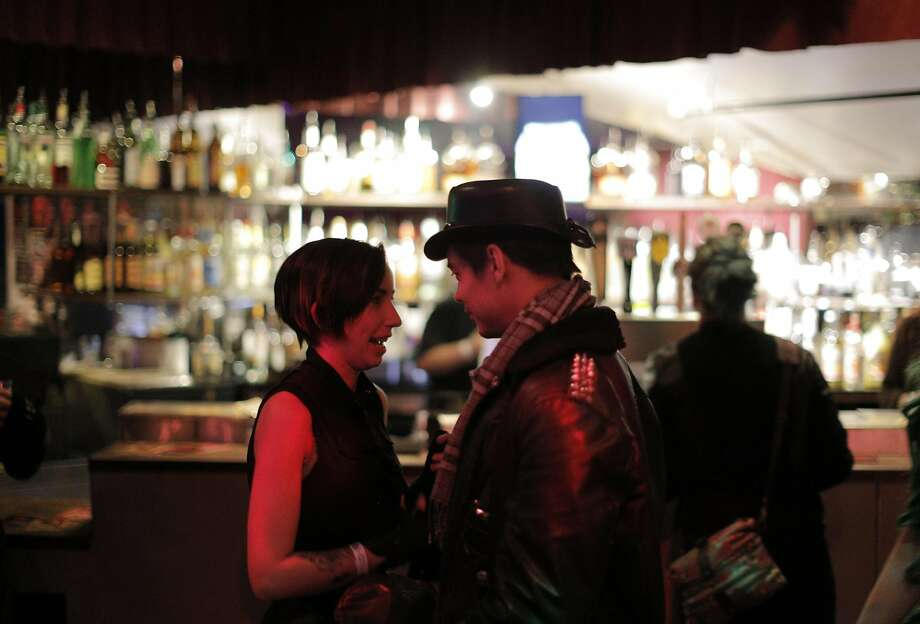 Performers Gothlet, left, and Jason Z, talk during a show at the DNA Lounge in San Francisco in December.Keep clicking to see the oldest bars in the Bay Area. Photo: Carlos Avila Gonzalez, The Chronicle