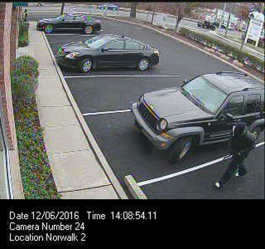 Police are asking the public's help locating a man who held up the First County Bank on Main Avenue in Norwalk on Dec. 6, 2016, and fled in a dark colored 2002-2007 Jeep Liberty. Photo: Norwalk Police