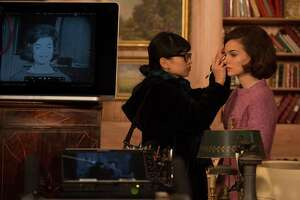 """Natalie Portman is shown on the set of """"Jackie."""" The movie offers a reminder that mannerly appearance and behavior can be used in the service of power."""