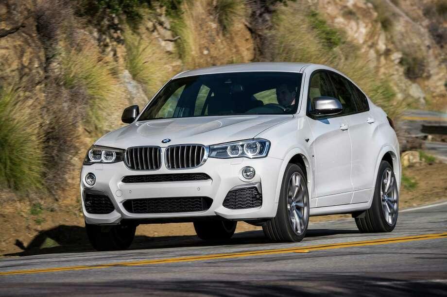 "The BMW X4 M40i's standard lighting gear includes auto-leveling Xenon adaptive headlights, LED fog lights and ""corona"" rings surrounding the headlights. Photo: BMW / Tom Kirkpatrick"