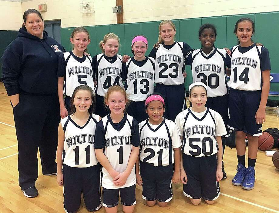 The Wilton 5th Grade girls basketball team includes: back row, from left, Coach Cricket Luke, Lauren Moe, Maddie Dineen, Kaitlyn Sullivan, Ashleigh Masterson, Anisa Burrows, Caroline Hage, and front row, from left, Marin Burke, Riley Fitzgerald, Siena McDermott, and Molly Hancock. Photo: Contributeed Photo / Hearst Connecticut Media / Norwalk Hour