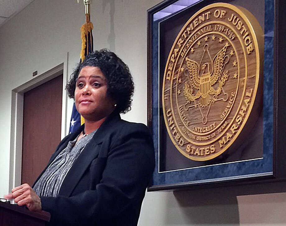 Tonya Granger describes her experiences with jury duty scam calls on Monday. Photo: Gabrielle Banks / Houston Chronicle
