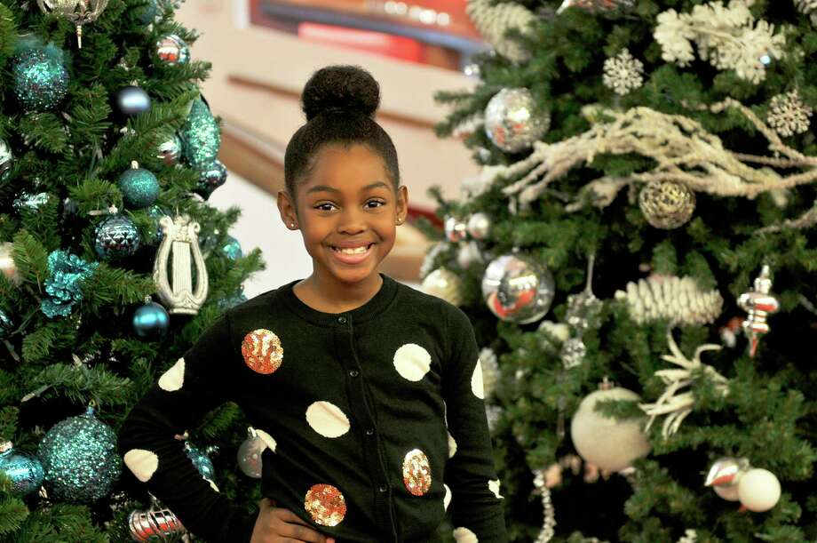 """Délani Koryn Allen, 10, of Clear Lake is cast as both both Tiny Tim and Boy Scrooge in Alley Theatre's production of """"A Christmas Carol — A Ghost Story of Christmas."""" The youngster, who is a fifth-grader at Clear Lake Christian School, learned to sing with a Cockney accent for the show. Photo: DGMumford / AlleyTheatre"""