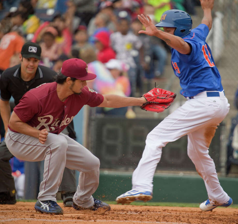 Midland RockHounds' Yairo Munoz avoids the tag at home for a run as Frisco's Yu Darvish tries to make the tag after a wild pitch Tuesday 05-17-16 at Security Bank Ballpark. Tim Fischer\Reporter-Telegram Photo: Tim Fischer/Midland Reporter-Telegram