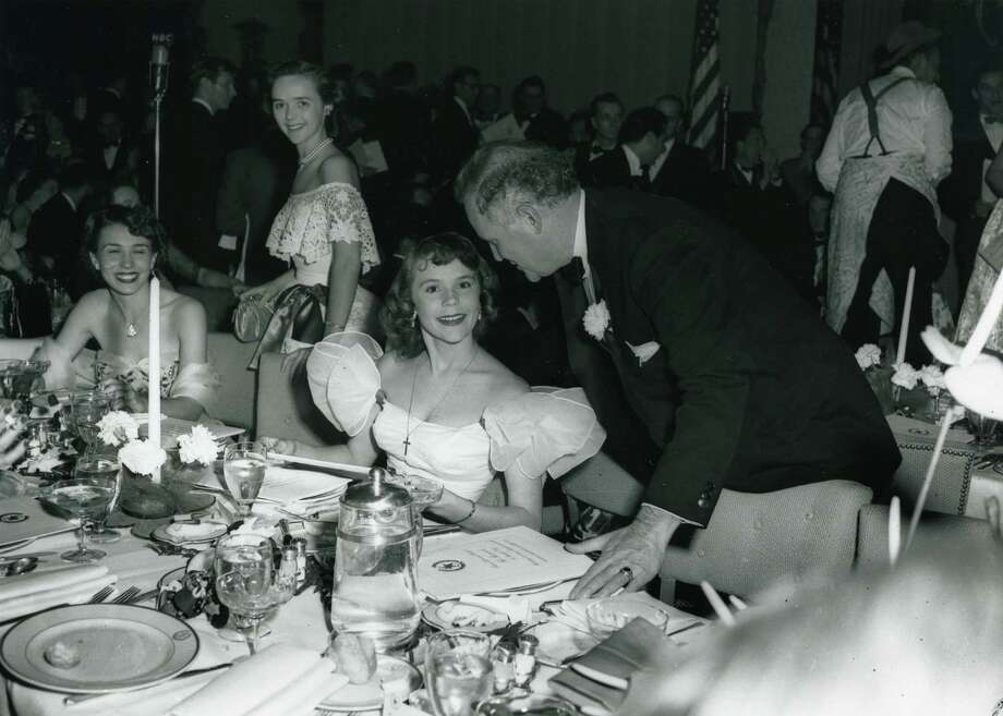 03/17/1949 - Gov. Beauford Jester speaks with Glenna McCarthy in the Emerald Ballroom at Shamrock Hotel's grand opening party, March 17, 1949. Photo: HP Staff / Houston Post Files