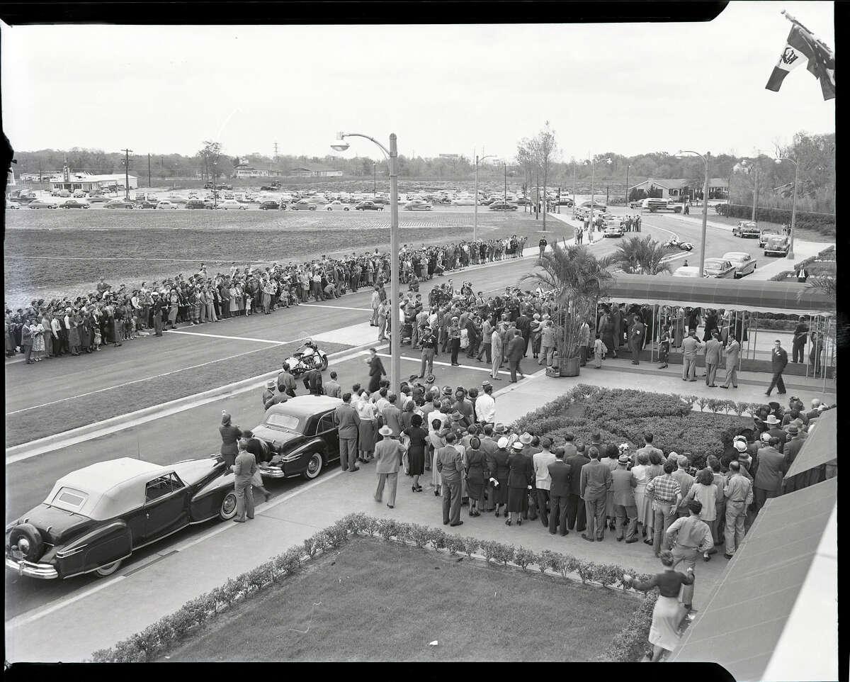 March 1949: Onlookers watch as photographers record ribbon cutting ceremonies at the grand opening of the Shamrock Hotel.